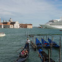 VENICE, ITALY - AUGUST 11:  A large cruise ship sails in St Mark's Basin in front of San Giorgio on August 11, 2011 in Venice, Italy. Italian heritage group Italia Nostra warned  that Venice is facing an irreversible environmental catastrophe unless visitor numbers are capped. The acceptable maximum number of tourists for Venice is 33,000. In 2011 the average number of visitors to the city daily is 60,000 that is too high for such a fragile city and is causing the gradual destruction of the lagoon ecosystem.