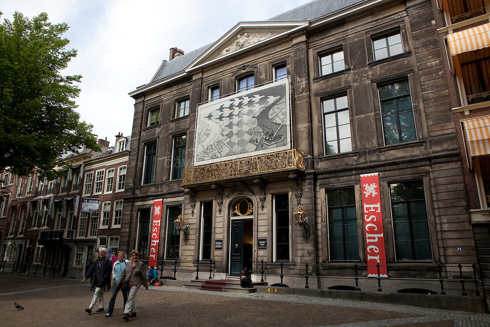 Tourists leaving the MC Escher Museum, Lange Voorhout Palace in Dn Haag
