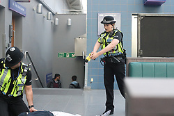 MANCHESTER UK 14.09.2017 A woman has been shot with tazer by a police officer on Mancheser Piccadily y train Station after Lounging at the officer with a  pair of scissors this evening in the middle of rush hour