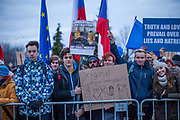 "Young prostestors with EU flag in front of  ""Top Hotel"" in Prague's quater Chodov (The quotation on the right by Vaclav Havel reads: ""Truth and love will prevail over lies and hatred""). They are protesting for European values and against the conference of the European anti-migrant parties ""Europe of Nations and Freedom"" (ENF). Attending were Marie Le Pen from France, Geert Wilders from Holland and Tomio Okamura of the Freedom and Direct Democracy (SPD) movement from Czech Republic which was hosting the meeting."