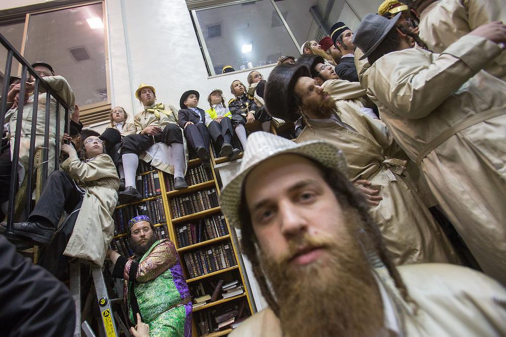 Ultra-orthodox man dressed in costumes at  Toldot Aharon Hasidic dynasty synagogue during Purim tish. Jerusalem, Israel, 25 February 2013.  Photo by Oren Nahshon.
