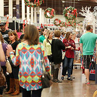 Thomas Wells   BUY AT PHOTOS.DJOURNAL.COM<br /> Shoppers make their way through this year's Celebration Village at the Tupelo Furniture Market.