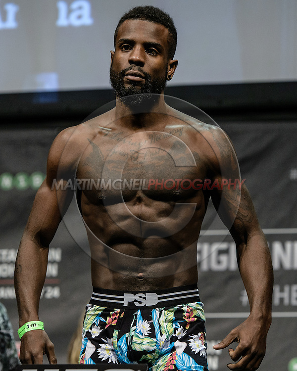"""STOCKHOLM, SWEDEN, JANUARY 23, 2015: Chris Beal poses on the scales during the official weigh in for """"UFC on Fox 14: Gustafsson vs. Johnson"""" inside Hovet Arena in Stockholm, Sweden"""