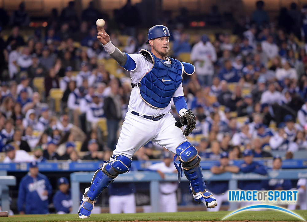 Apr 13, 2016; Los Angeles, CA, USA; Los Angeles Dodgers catcher Yasmani Grandal (9) throws to first base against the Arizona Diamondbacks during a MLB game at Dodger Stadium.