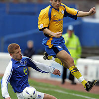 Queen of the South v St Johnstone...16.10.04<br />Lee Hardy jumps out of the way of Gary Wood's challenge.<br /><br />Picture by Graeme Hart.<br />Copyright Perthshire Picture Agency<br />Tel: 01738 623350  Mobile: 07990 594431