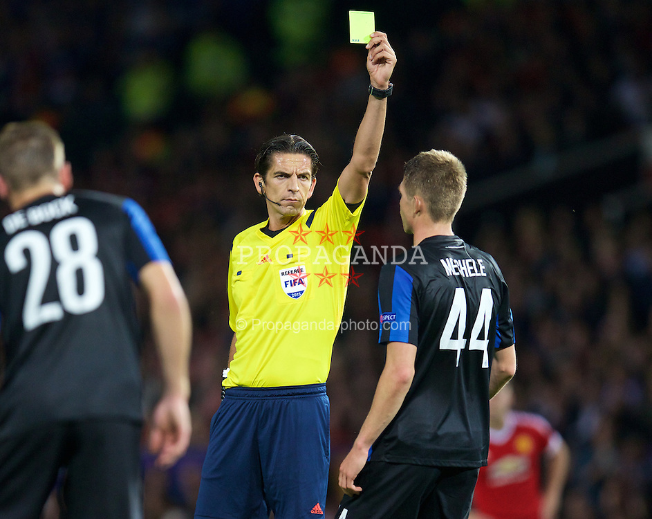 MANCHESTER, ENGLAND - Tuesday, August 18, 2015: Club Brugge's Brandon Mechele is shown his first yellow card by referee Deniz Aytekin during the UEFA Champions League Play-Off Round 1st Leg match against Manchester United at Old Trafford. (Pic by David Rawcliffe/Propaganda)