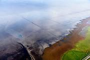 Nederland, Friesland, Het Bildt, gemeente Waadhoeke, 04-11-2018; Noord-Friesland Buitendijks, kweldergebied Noorderleeg, waddenkust en landaanwinning. Uitwatering van de Kouwe Faart op het wad, bij Zwarte Haan.<br /> Fries: Noarderleech , onderdeel van Noard-Frysl&acirc;n B&ucirc;tendyks.<br /> Frisian coast, salt marsh and mudflat area with land reclamation, <br /> luchtfoto (toeslag op standaard tarieven);<br /> aerial photo (additional fee required);<br /> copyright &copy; foto/photo Siebe Swart