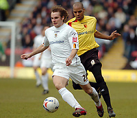 Photo: Leigh Quinnell.<br /> Watford v Luton Town. Coca Cola Championship. 09/04/2006. Watfords Marlon King is on the tail of Lutons Markus Heikkinen.