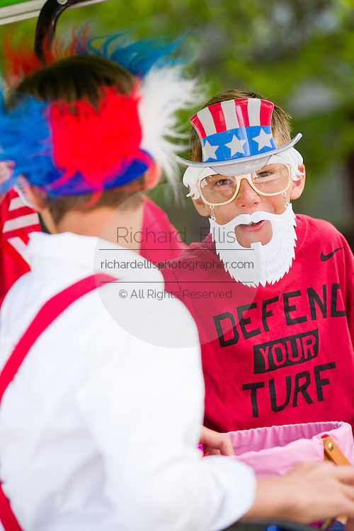 Young boys wearing patriotic costume during the I'On neighborhood Independence Day parade July 4, 2015 in Mt Pleasant, South Carolina.