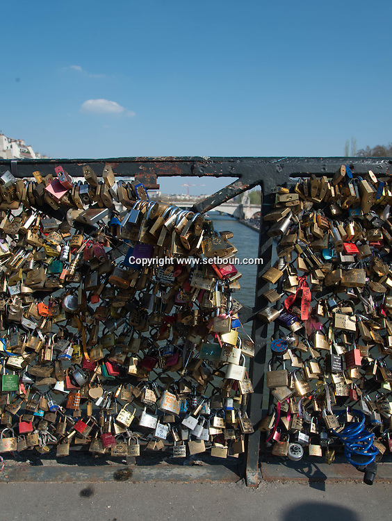 France. Paris 5th district. Archeveche bridge.  love locks  on the  seine river  beetween left bank and ile de la cite  / cadenas d amour sur le pont de l archeveche sur la seine entre l ile de la cite et la rive gauche