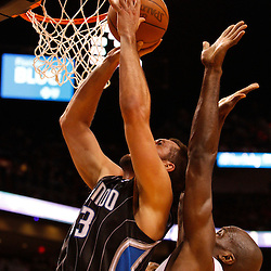 March 3, 2011; Miami, FL, USA; Orlando Magic power forward Ryan Anderson (33) shoots over Miami Heat center Erick Dampier (25) during the second quarter at the American Airlines Arena.    Mandatory Credit: Derick E. Hingle