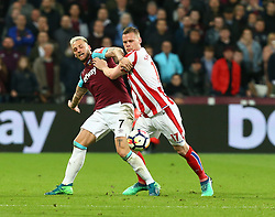 April 16, 2018 - London, England, United Kingdom - West Ham United's Marko Arnautovic tussle with Stoke City's Ryan Shawcross.during English Premier League match between West Ham United and Stoke City at London stadium, London, England on 16 April 2018. (Credit Image: © Kieran Galvin/NurPhoto via ZUMA Press)