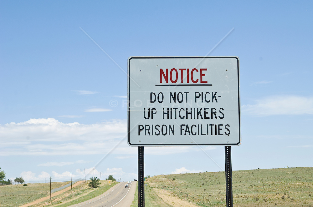 Warning sign on a highway to beware of escaped prisoners.