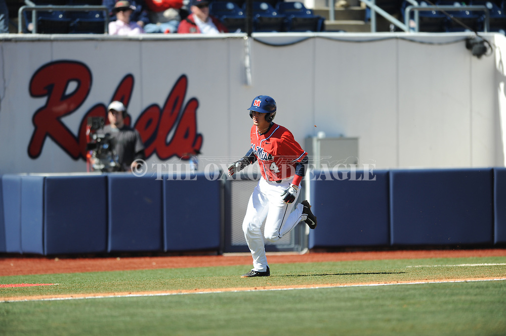 Ole Miss' Tate Blackman scores vs. Stetson at Oxford-University Stadium in Oxford, Miss. on Saturday, March 7, 2015. Ole Miss won 8-3 in game 1 of a doubleheader to improve to 7-5.