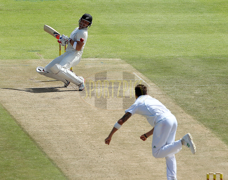 Brendon McCullum is hit by a delivery from Dale Steyn during the 2nd day of the 1st Sunfoil Test match between South Africa and New Zealand held at Newlands Stadium in Cape Town, South Africa on the 3rd January 2013..Photo by Ron Gaunt/SPORTZPICS .