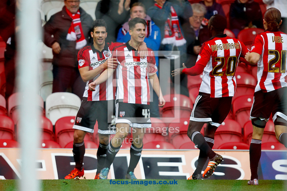 Sergi Can&oacute;s of Brentford celebrates scoring the opening goal during the Sky Bet Championship match between Brentford and Huddersfield Town at Griffin Park, London<br /> Picture by Mark D Fuller/Focus Images Ltd +44 7774 216216<br /> 19/12/2015