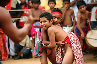 Wayuu Indian boys compete in traditional wrestling at the annual Wayuu Cultural Festival in Uribia, Colombia June 9, 2007. (Photo/Scott Dalton)