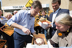 © Licensed to London News Pictures. 04/05/2015. Carshalton, UK.  Deputy Prime Minister, Nick Clegg cuts a cake with Liberal Democrat candidate for Carshalton and Wallingdon, Tom Brake and supporters in Carshalton. Photo credit : Vickie Flores/LNP