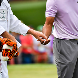 Apr 13, 2019; Augusta, GA, USA; Tiger Woods hands a ball to caddie Joe Lacava on the 2nd green during the third round of The Masters golf tournament at Augusta National Golf Club.Photo : Michael Madrid / SUSA / Icon Sport