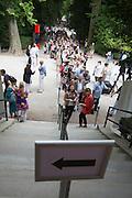 54th Biennale of Venice..ILLUMInazioni - ILLUMInations.Giardini, British Pavillion.People cueing to see the installation by Mike Nelson, 2011.