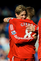 LIVERPOOL, ENGLAND - Saturday, September 27, 2008: Liverpool's Fernando Torres and captain Steven Gerrard MBE celebrate their side's 2-0 victory against Everton during the 208th Merseyside Derby match at Goodison Park. (Photo by David Rawcliffe/Propaganda)