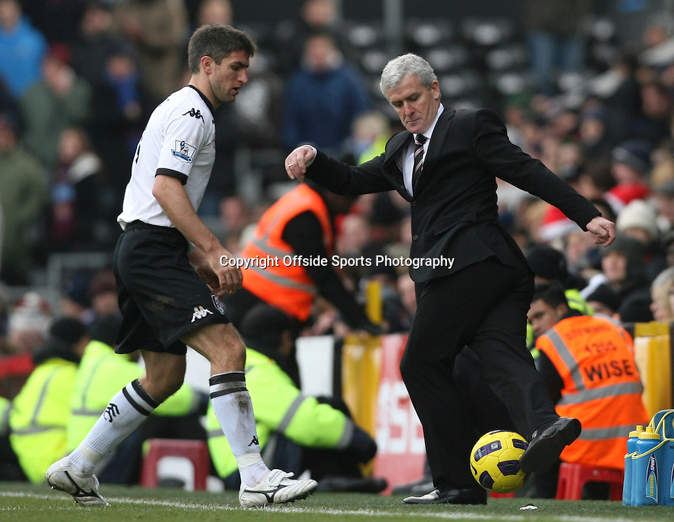 26/12/2010 - Barclays Premier League - Fulham vs. West Ham United - Fulham manager Mark Hughes controls the ball on the sideline - Photo: Simon Stacpoole / Offside.