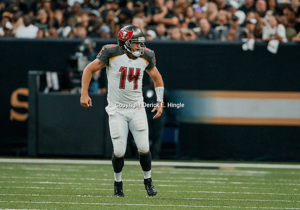 Sep 9, 2018; New Orleans, LA, USA; Tampa Bay Buccaneers quarterback Ryan Fitzpatrick (14) celebrates after a touchdown pass during the fourth quarter of a game against the New Orleans Saints at the Mercedes-Benz Superdome. The Buccaneers defeated the Saints 48-40. Mandatory Credit: Derick E. Hingle-USA TODAY Sports