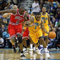 February 12, 2011; New Orleans, LA, USA; New Orleans Hornets guard Marcus Thornton (5) drives past Chicago Bulls small forward Luol Deng (9) during the second quarter at the New Orleans Arena.   Mandatory Credit: Derick E. Hingle