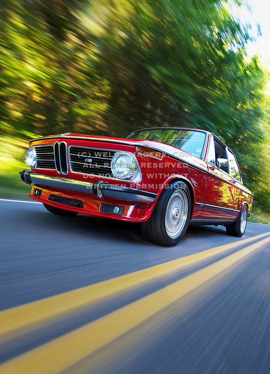 Image of a red 1973 BMW 2002 hot rod on a country road, Oregon, Pacific Northwest