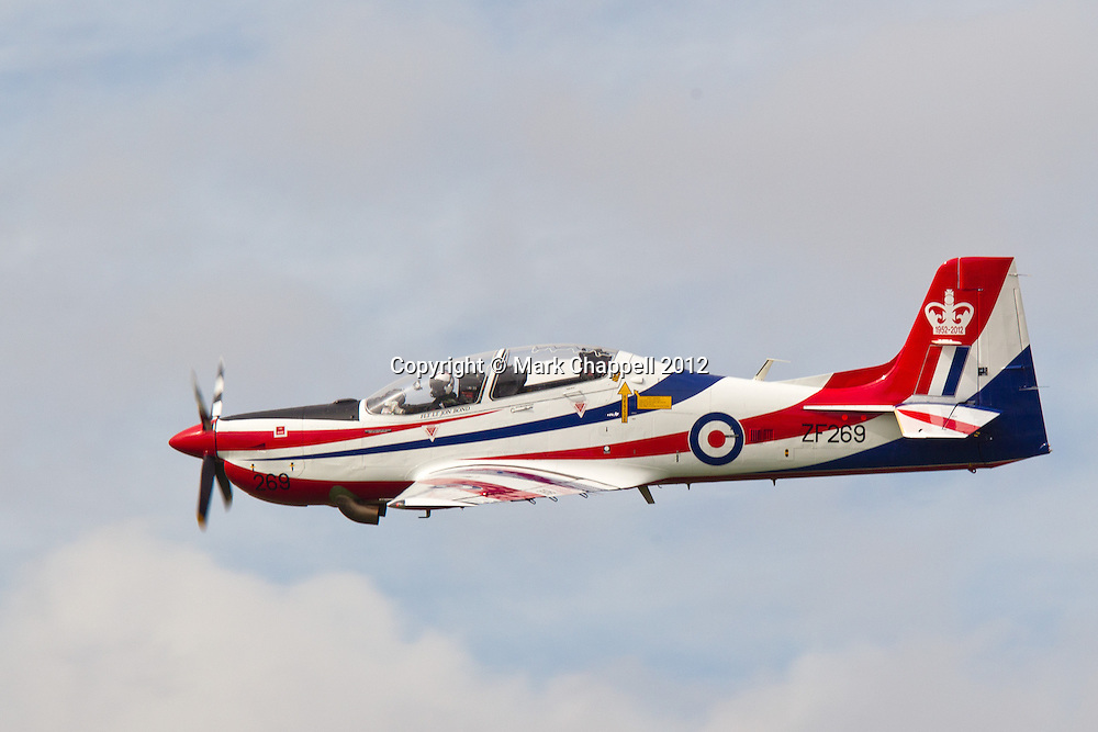 A Tucano advanced trainer solo display from 207(R) Sqn, RAF Valley  at the Cotswold Air Show/Best of Britain Show. The Tucano, flown by Fgt Lt Jon Bond, has been painted to celebrate HM The Queen's Diamond Jubilee for the 2012 season. Cirencester, UNITED KINGDOM. August 26 2012..Photo Credit: Mark Chappell.© Mark Chappell 2012. All Rights Reserved. See instructions.