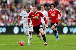 Wayne Rooney of Manchester United is challenged by Ashley Williams of Swansea City - Mandatory byline: Rogan Thomson/JMP - 07966 386802 - 30/08/2015 - FOOTBALL - Liberty Stadium - Swansea, Wales - Swansea City v Manchester United - Barclays Premier League.