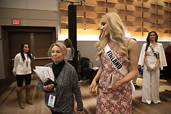 December 5, 2019, Atlanta, GA: Anni HarjunpÅÅ, 23,  greets media on first day of preparations for Miss Universe competition. She hadnÃ•t entered any beauty pageants  until 2019, when she was crowned Miss Finland earlier this year.  .Pictured: Anni is escorted by her contest manager back to her room after meeting with media, to prepare for meeting with judges. (Credit Image: © Robin Rayne/ZUMA Wire)