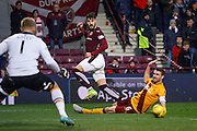 Hearts FC Defender Callum Paterson playing the cross during the Ladbrokes Scottish Premiership match between Heart of Midlothian and Motherwell at Tynecastle Stadium, Gorgie, Scotland on 16 January 2016. Photo by Craig McAllister.