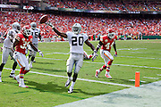 KANSAS CITY, MO - SEPTEMBER 20:   Darren McFadden #20 of the Oakland Raiders throws the ball to the official after scoring a touchdown against the Kansas City Chiefs at Arrowhead Stadium on September 20, 2009 in Kansas City, Missouri.  The Raiders defeated the Chiefs 13-10.  (Photo by Wesley Hitt/Getty Images) *** Local Caption *** Darren McFadden