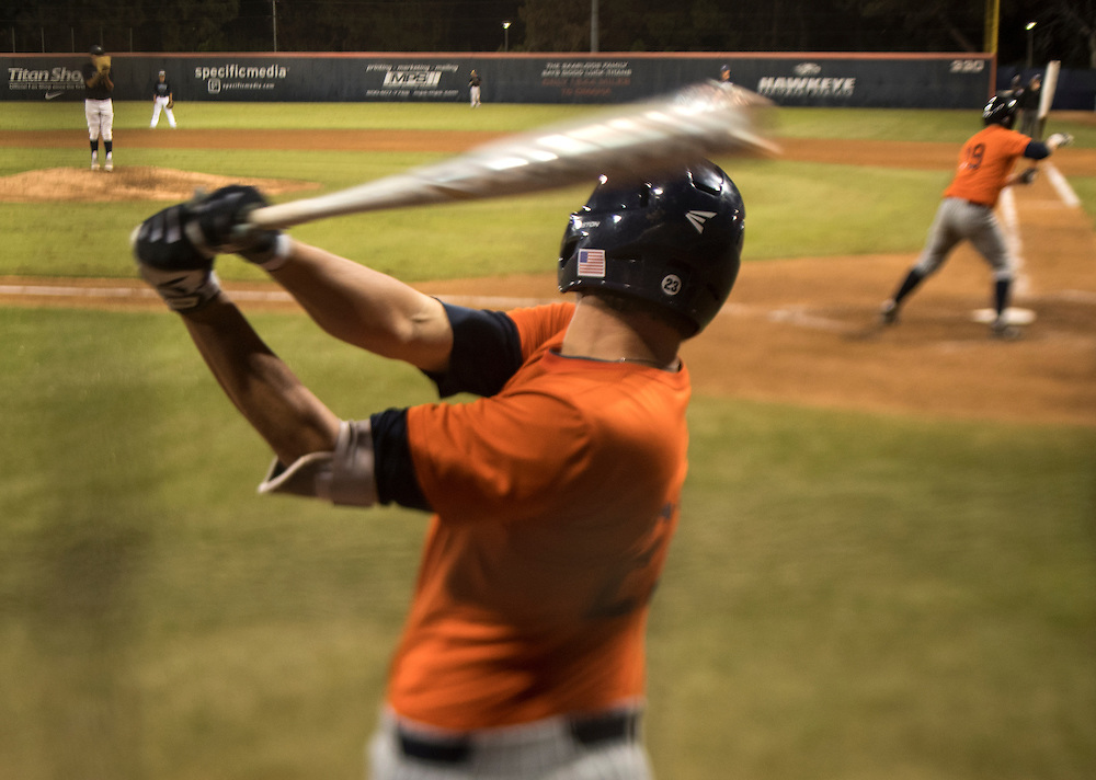 Jake Pavletich of California State-Fullerton takes a practice swing during their game against Cypress College at Goodwin Field in Fullerton, Calif. on Nov. 4, 2016.