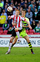 Sheffield United's Dave Kitson holds up the ball from Yeovil Town's Dan Burn - Photo mandatory by-line: Dougie Allward/JMP - Tel: Mobile: 07966 386802 03/05/2013 - SPORT - FOOTBALL - Bramall Lane - Sheffield - Sheffield United V Yeovil Town - NPOWER LEAGUE ONE PLAY-OFF SEMI-FINAL FIRST LEG