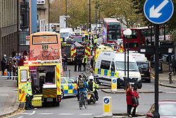 Ladbroke Grove, London, November 17th 2016. A double decker bus crashes into Kensal House on Ladbroke Grove prompting a major response from the emergency services including the air ambulance. According to Detective Chief Superintendent Ellie O'Connor of Met Police Kensington and Chelsea, 14 people including the driver were hurt, with none sustaining life-threatening or life changing injuries. Police officers would not speculate on the cause of the accident, but apologised for delays and commended all branches of the emergency services for their prompt and efficient response. The bus will be towed away for further investigations. PICTURED: Ladbroke Grove is clogged with vehicles from the emergency services.
