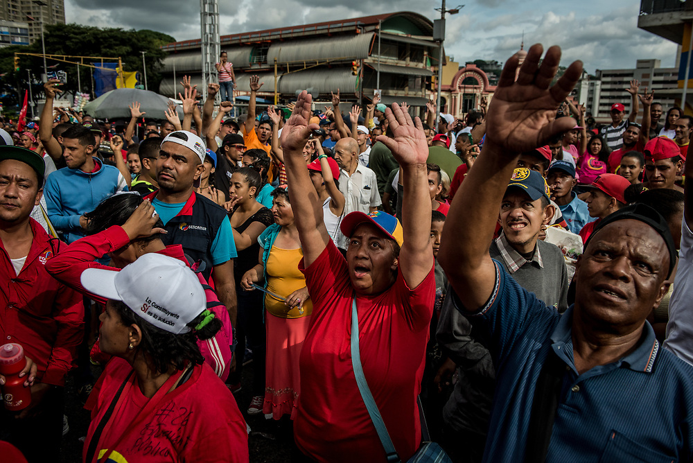 CARACAS, VENEZUELA - JULY 27, 2017: Government supporters celebrate the final campaign rally for candidates for the election of the new constituent assembly, that will be held on July 30th. They marched and danced in the streets, as President Maduro and other socialist leaders addressed the large crowd. Opponents of the government criticize President Maduro for calling for this election - saying the new assembly is a power grab, and will be a puppet of the President - the only candidates on the ballot are government loyalists. Critics also fear the new assembly will re-write the constitution and wipe out the democratically elected and opposition controlled congress. There have been widespread reports of voter intimidation, and of the government threatening state workers and citizens that receive government benefits like subsidized food - who report the government telling them they are obligated to vote, and if they don't, they will lose their jobs and benefits. Thousands have taken to the streets to protest the election in the days leading up to the July 30th vote.  PHOTO: Meridith Kohut for The New York Times