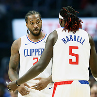 LOS ANGELES, CA - OCT 28: Kawhi Leonard (2) of the LA Clippers talks to Montrezl Harrell (5) of the LA Clippers during a game on October 28, 2019 at the Staples Center, in Los Angeles, California.