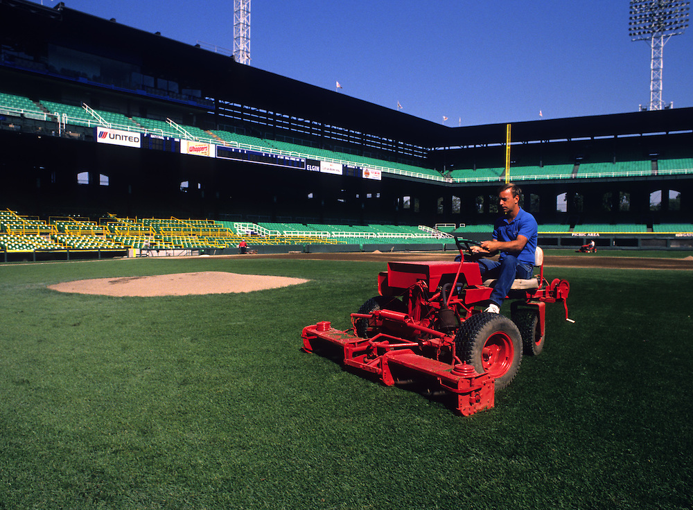 CHICAGO, IL - 1988:  White Sox groundskeeper Roger Bossard mows the infield grass at old Comiskey Park in Chicago, Illinois.  Old Comiskey Park was demolished in 1991.  (Photo by Ron Vesely)