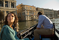 Girl, 14, and boy, 16, in gondola boat at sunset, Venice, Italy