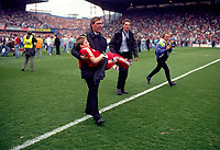 A Young Liverpool Fan is carried away to safety.<br />The Tragic FA Cup Semi Final between Liverpool Vs Nottingham Forest where Sadly 96 Liverpool fans lost their lives because of Overcrowding at the Hillsborough Stadium Sheffiled 15th April 1989<br />PHOTO ROBIN PARKER FOTOSPORTS INTERNATIONAL
