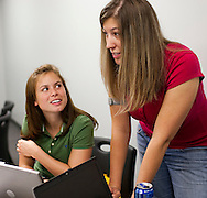 UI student and current intern Leah Zmolek and UI graduate and former intern Cassidy Whitmore at Genencor in Cedar Rapids on Friday July 24, 2009.  (Stephen Mally/Freelance)