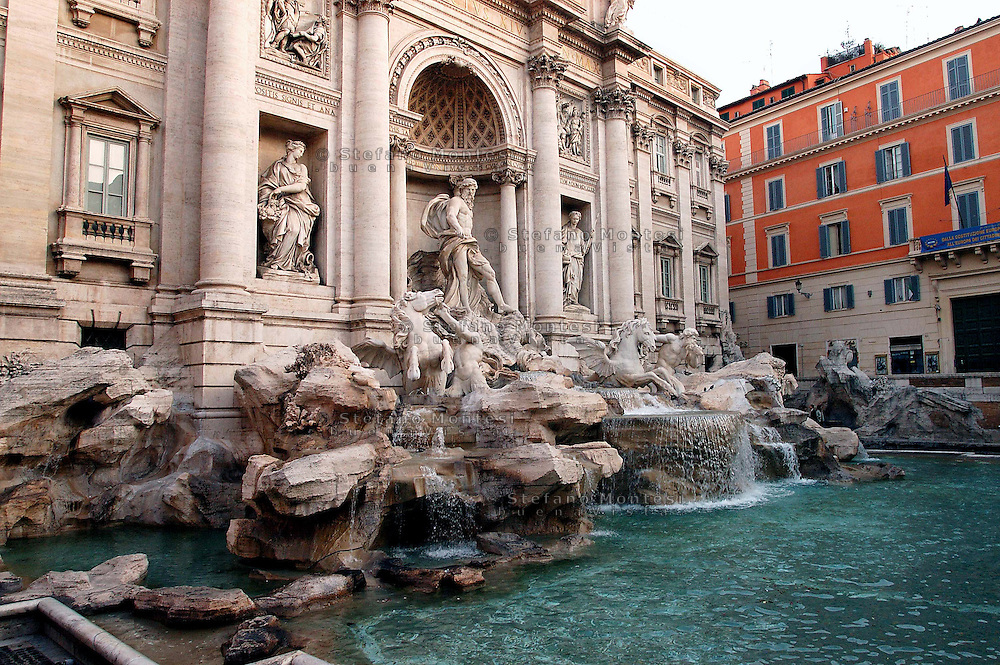The Trevi Fountain (Fontana di Trevi) is Rome's most impressive and popular fountain. Possibly based on a design by Bernini, the fountain was built after his death by Niccolo Salvi between 1732 and 1751. The sea God Neptune at the centre of the fountain was added by Pietro Bracci in 1762. Rome, Italy.