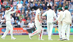 England's Joe Root shows his dejection as Pakistan's Mohammad Amir celebrates taking his wicket, during day two of the Second Natwest Test match at Headingley, Leeds.