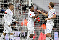 Raheem Sterling ( C ) of England celebrates with Harry Kane ( R ) and Jamie Vardy after he scores to make it 2-0 - Mandatory byline: Paul Terry/JMP - 07966 386802 - 09/10/2015 - FOOTBALL - Wembley Stadium - London, England - England v Estonia - European Championship Qualifying - Group E