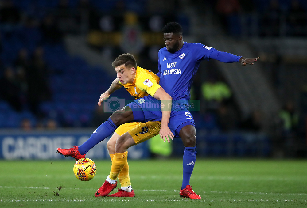 Preston North End's Jordan Hugill (left) and Cardiff City's Bruno Ecuele Manga battle for the ball during the Sky Bet Championship match at The Den, London.