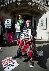 © Licensed to London News Pictures. 29/02/2016. London, UK.  Wheelchair bound campaigner CLAIRE GASMAN (front)  joins other Campaigner outside the Supreme Court in London where Justices are due to hear appeals against the under occupancy subsidy, also known as the bedroom tax.  Campaigners believe the reduction in benefits for people in a housing association property that has one or more spare bedrooms, is having a devastating impact on vulnerable people.  Photo credit: Ben Cawthra/LNP
