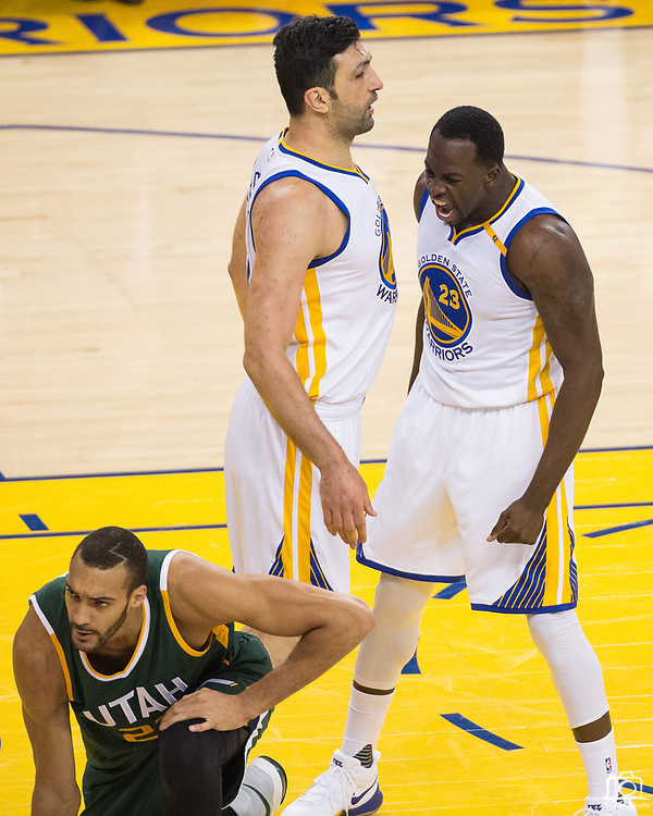 Golden State Warriors forward Draymond Green (23) and Golden State Warriors center Zaza Pachulia (27) celebrate a steal against the Utah Jazz during Game 1 of the Western Conference Semifinals at Oracle Arena in Oakland, Calif., on May 2, 2017. (Stan Olszewski/Special to S.F. Examiner)