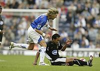 Photo: Aidan Ellis.<br /> Blackburn Rovers v Wigan Athletic. The Barclays Premiership. 01/10/2006.<br /> Blackburn's Robbie Savage challenges Wigan's Denny Landzat